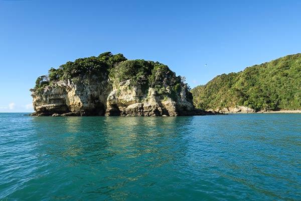 That's OK, we'll anchor here behind Motu Island.
