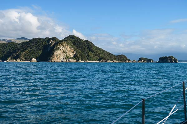 Our first glimpse of the Tata Islands, the two small islands at the right of the photo.